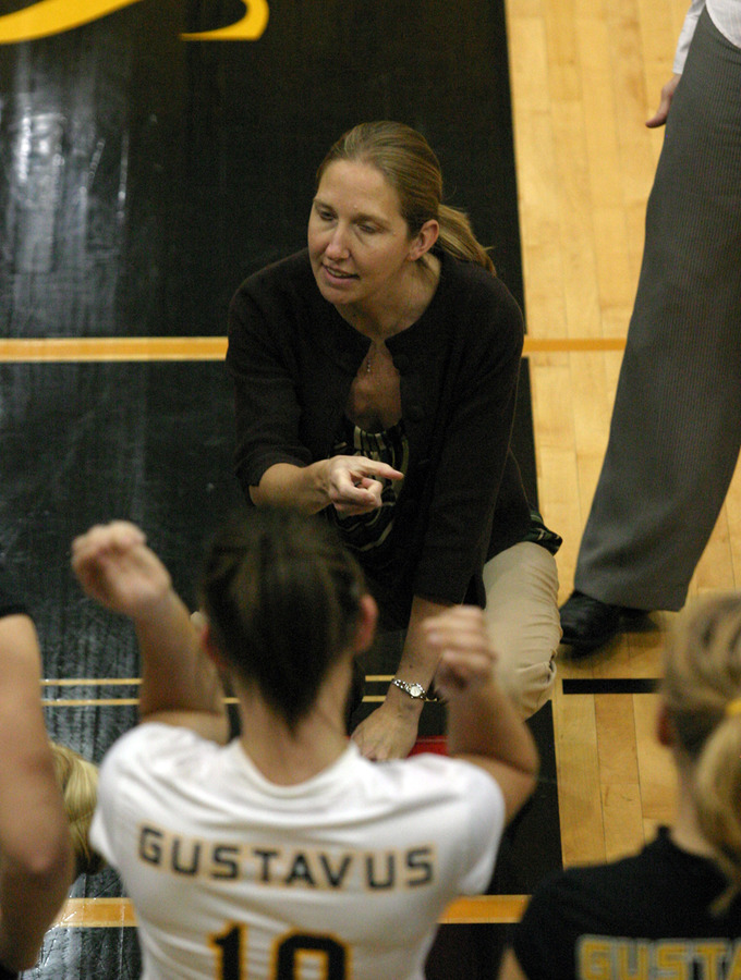 Head Coach Kari Eckheart talks to the team during a timeout.