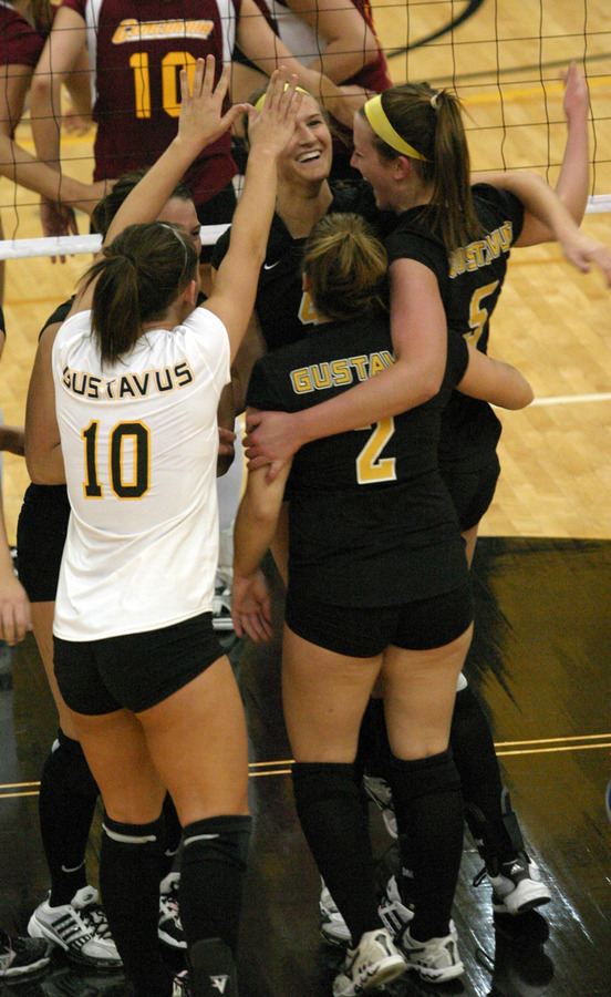 Gustavus celebrates after winning the match.