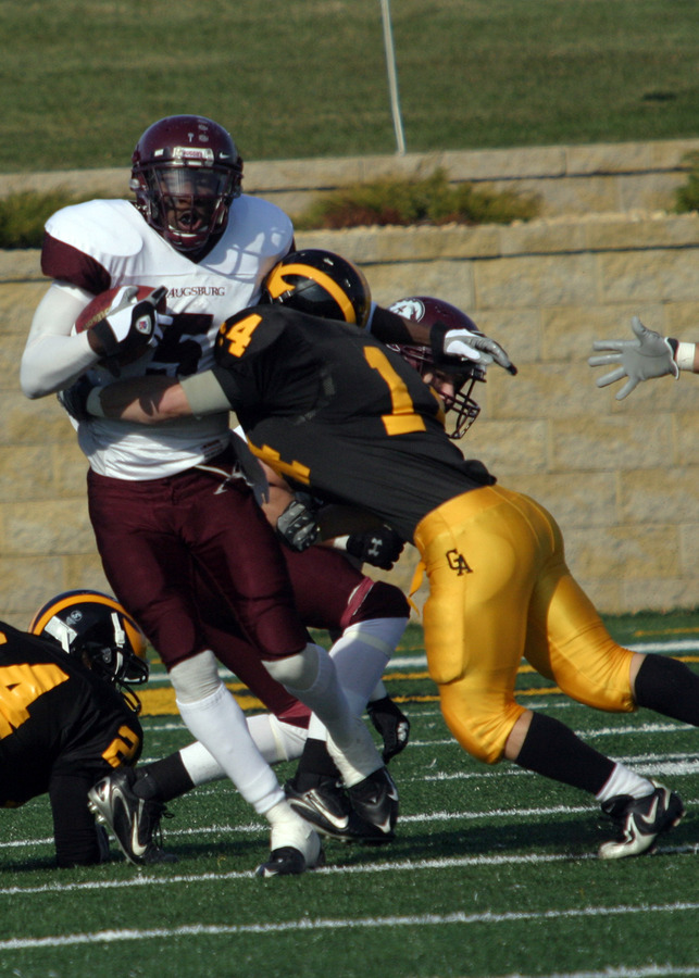 T.J. Ridley tackles an Augsburg wide receiver.