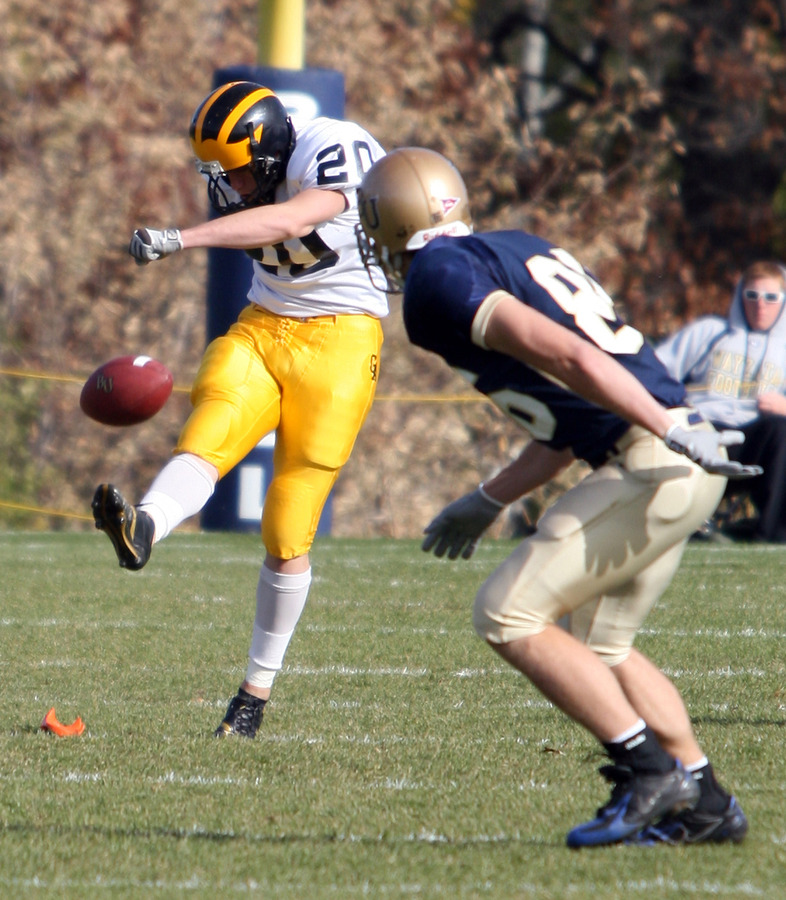 John Ostertag kicks off against Bethel. (Photo Courtesy: Ryan Coleman)