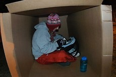 A Gustavus student studies during a past Hunger and Homelessness Week sleep out.