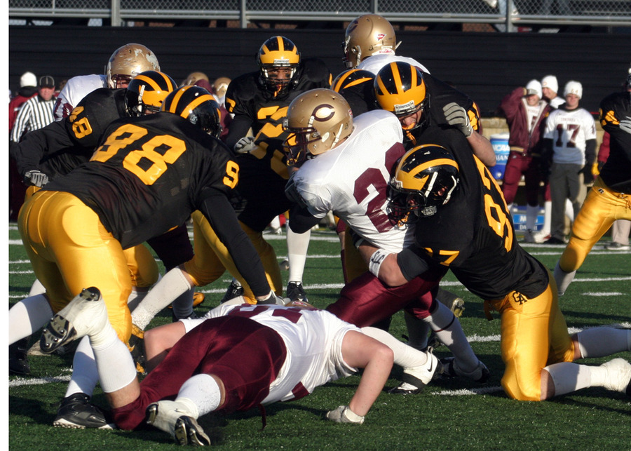 Ted Aleckson stops the Cobber player behind the line of scrimmage.