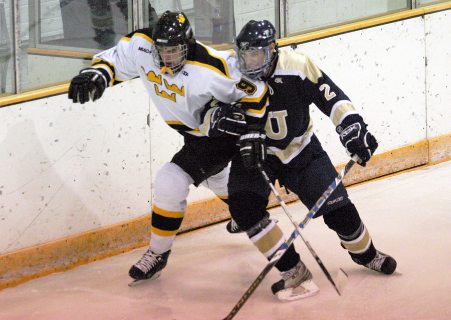 Two skaters fight for position for the puck.