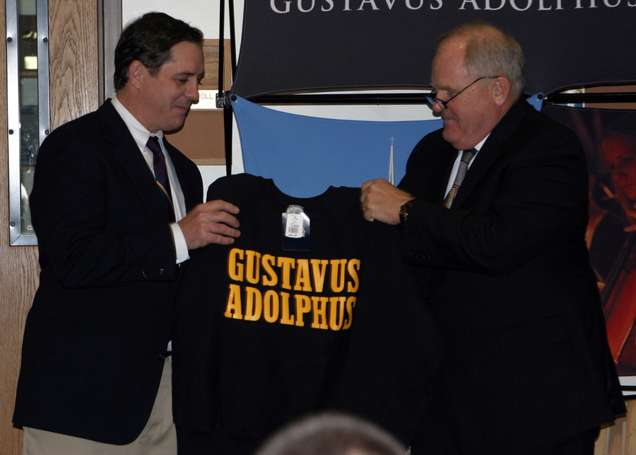 Athletics Director Al Molde presenting a Gustavus sweatshirt to Haugen.
