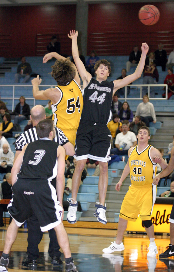 Sam Paulson and Andy Grzesiak-Grimm take the jump ball.