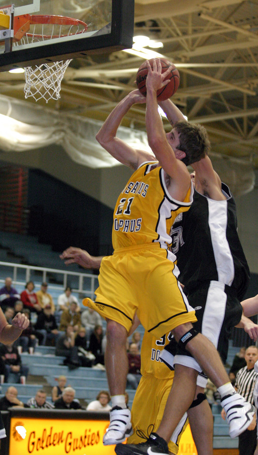 Jesse Van Sickle is fouled as he goes up for the layup.