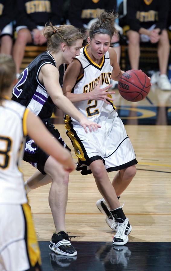 Molly Geske drives to the basket. (photo by A.J. Dahm, SportPix)