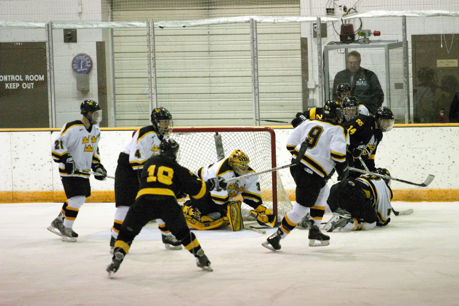 Matt Lopes makes a save during a scramble in front of the net.