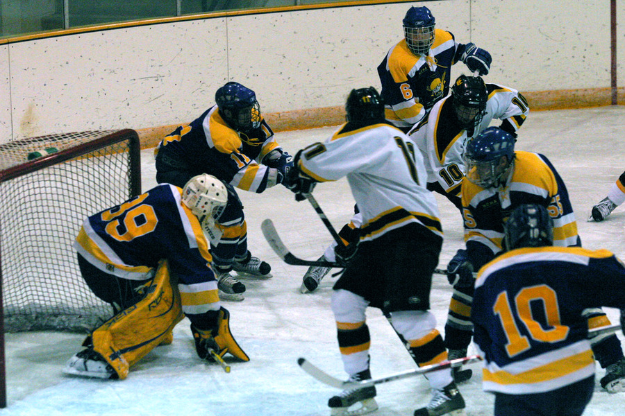 Gustavus pressures the Saints' goaltender in first period.