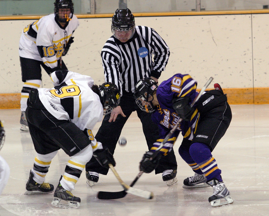 Melissa Mackley (#9) of Gustavus faces off with Jenna Daggit (#16) of UWSP