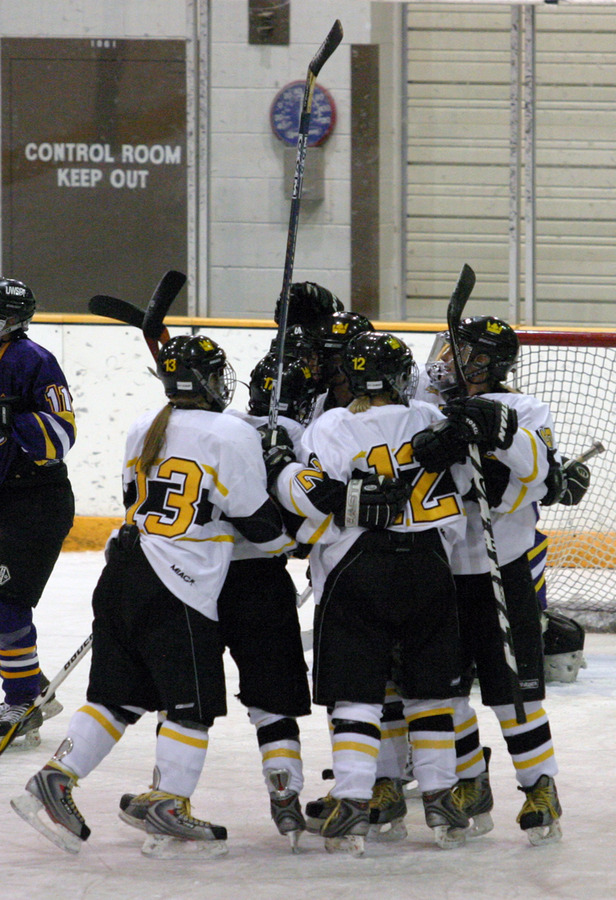 Gustavus celebrates Christine Wicker's power play goal in the first period.