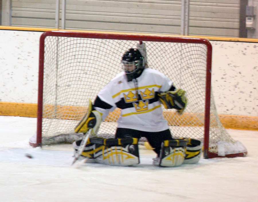 Emily Klatt records one of her 12 saves.