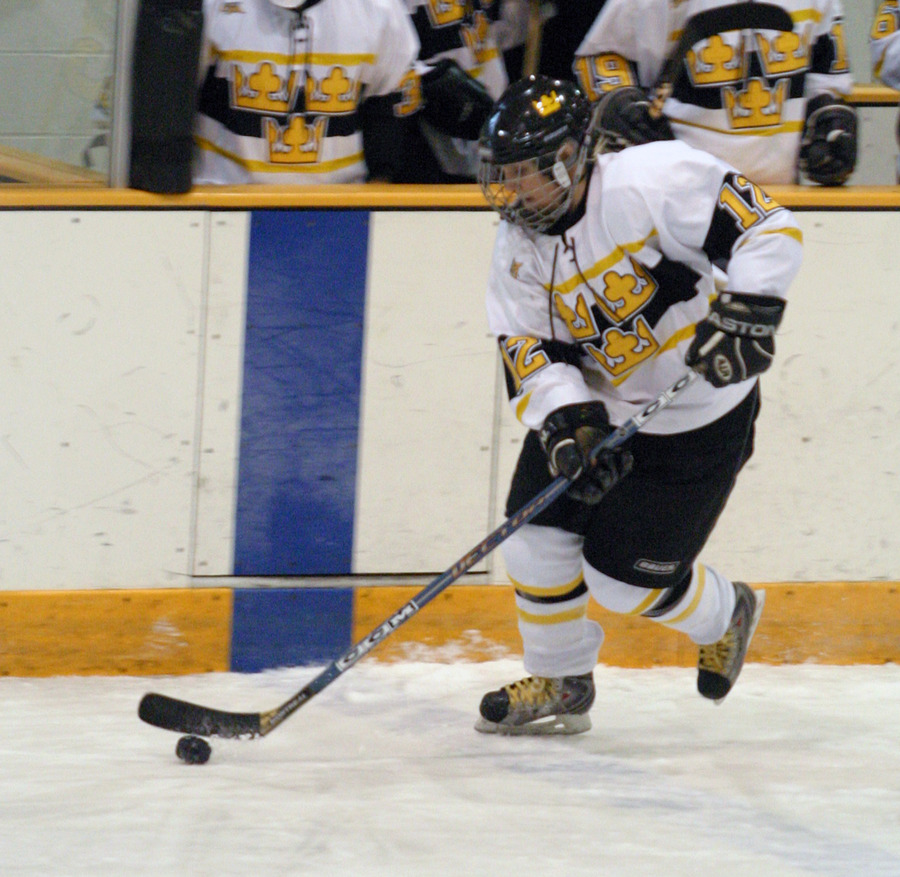 Jessie Doig carries the puck up the ice.