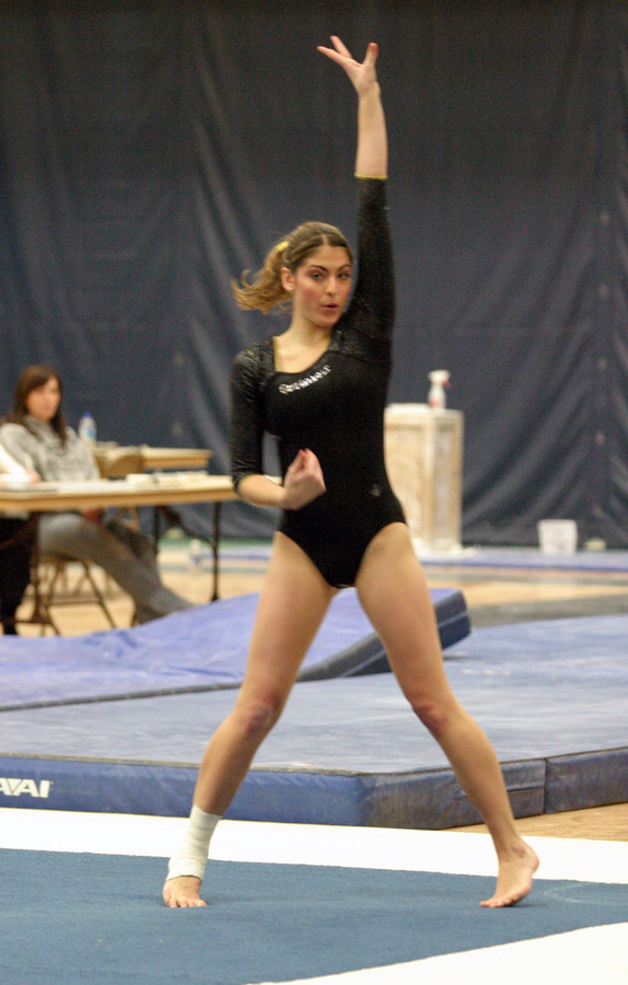 Aryn Bell gets ready to start a tumbling pass on the floor exercise.
