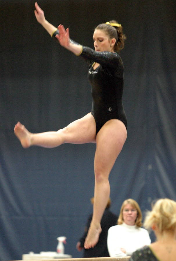 Meghan Johnson performs a leaping element on the balance beam.