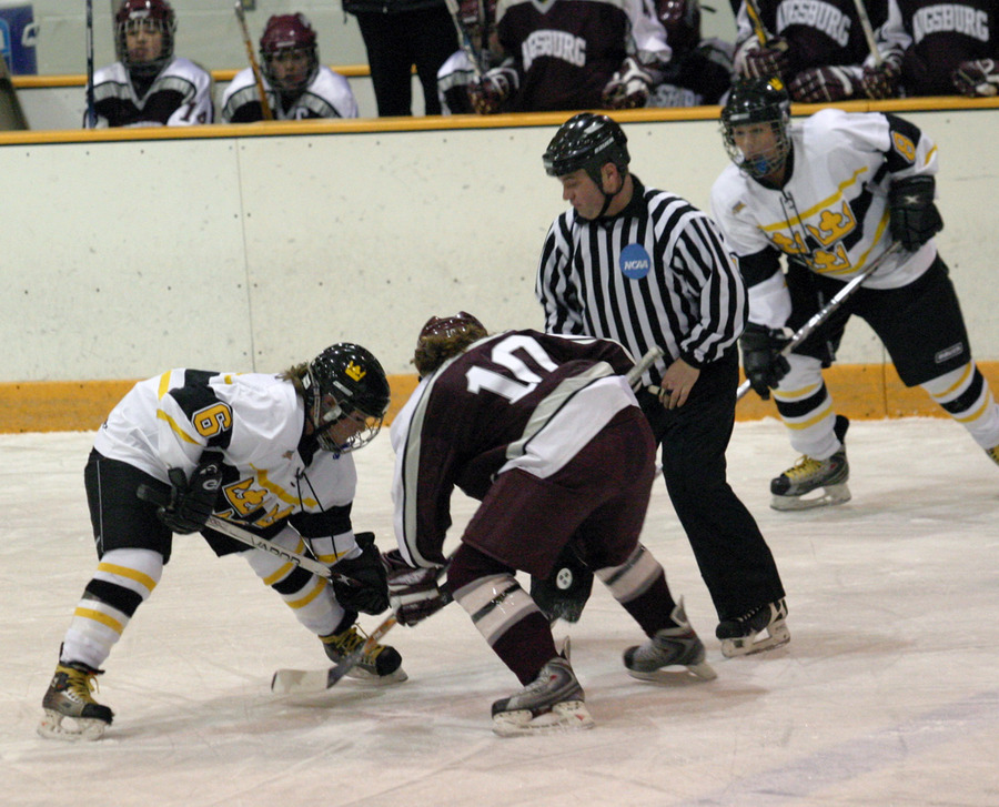 Whitney Schaff of Gustavus faces off with Amanda Gullickson of Augsburg.