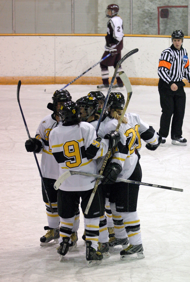 The Gusties celebrate Jessie Doig's first period goal.