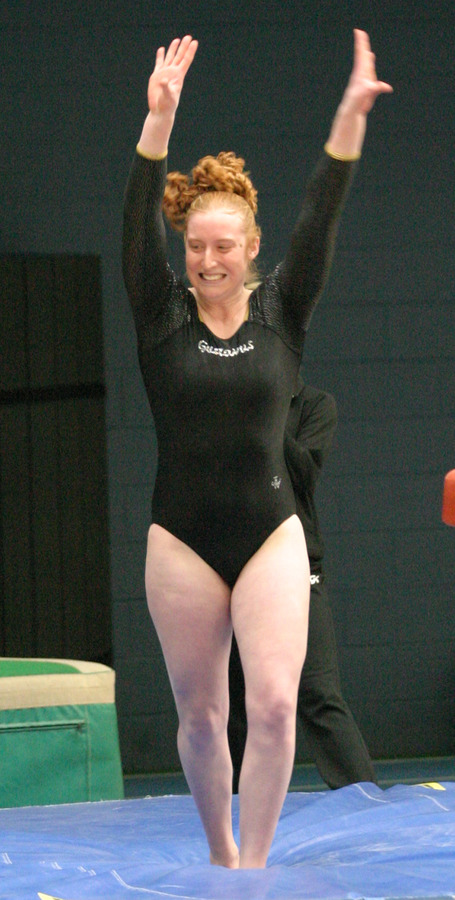 Breann Moore smiles after sticking her landing on the vault.