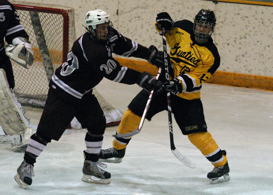 Mike Carr battles for position in front of the Augsburg net.