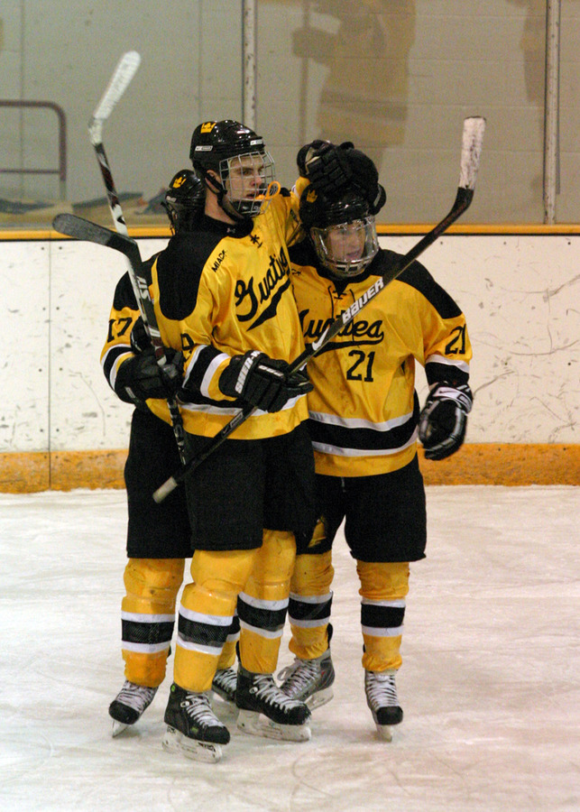Eric Bigham, Joe Welch, and James Leathers celebrate after a goal.