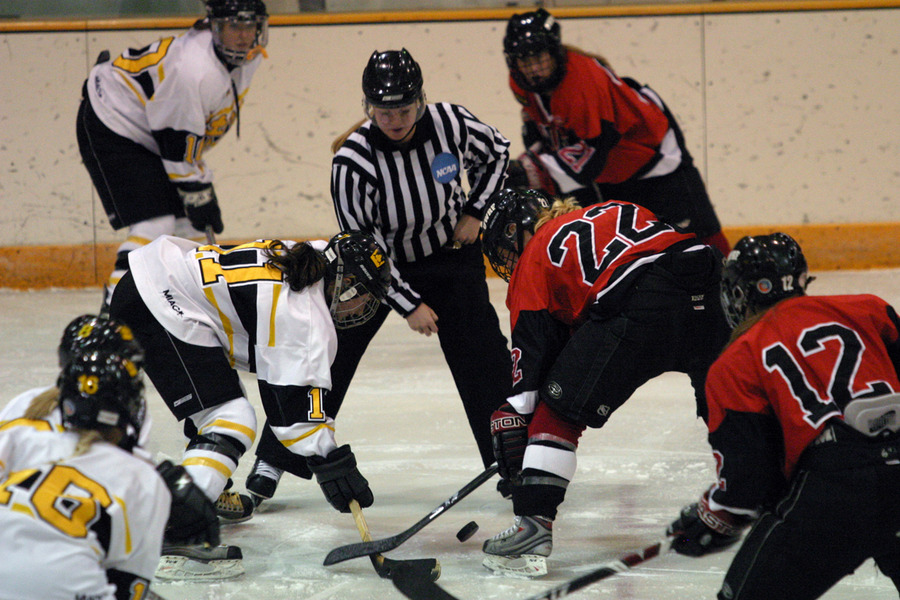Gustavus' Lynn Hillen (#11) faces off with Jessica Thompson (#22) of UW-River Falls.