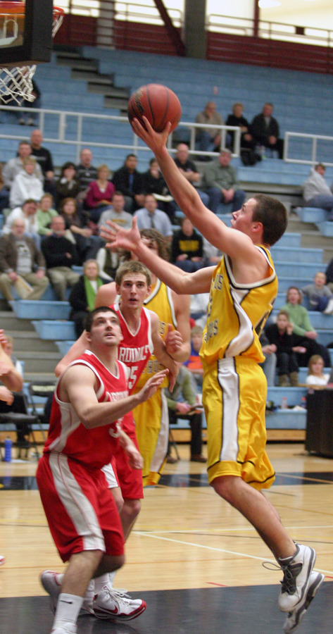 Phil Wirtjes lays in two of his nine points in the second half.