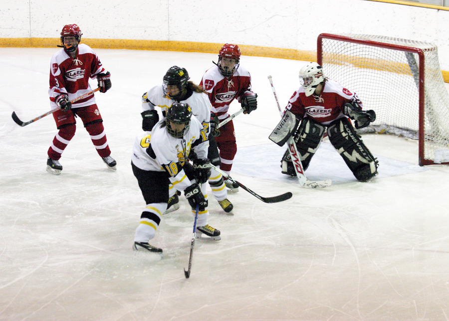 Nara Higano and Laura Hillman screen Blazer goaltender Abbie Helminen.