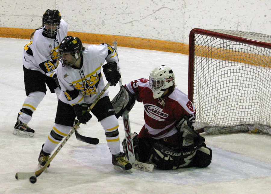 Lynn Hillen controls the puck right in front of the St. Ben's net while Alyssa Gaulrapp covers the back post.