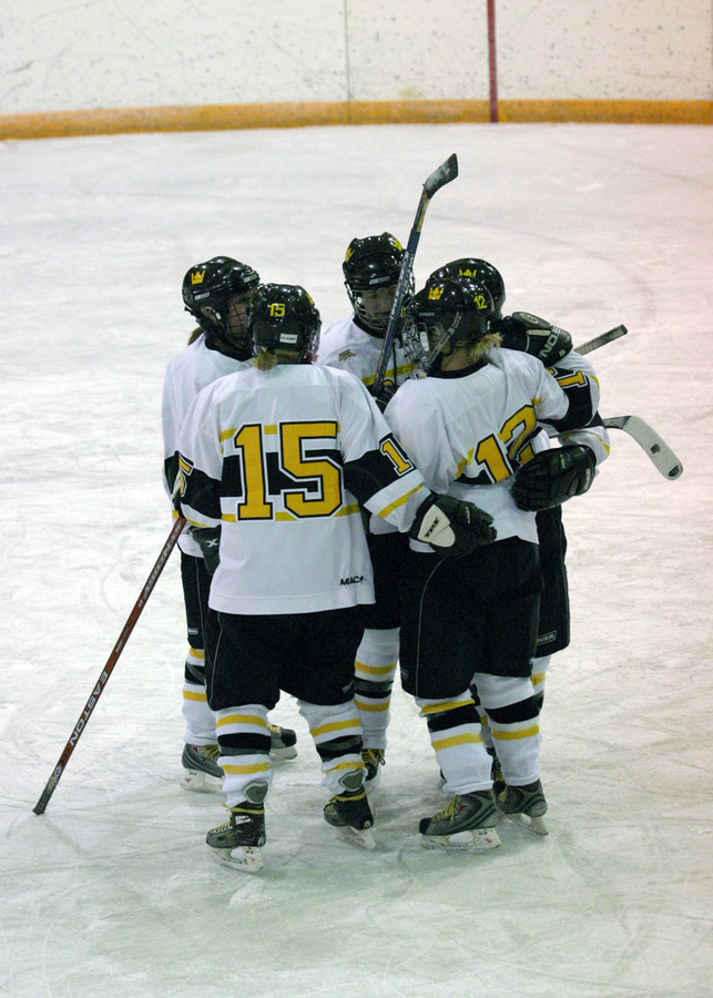 The Gusties celebrate with Jesse Doig (#12) after her goal late in the first period.