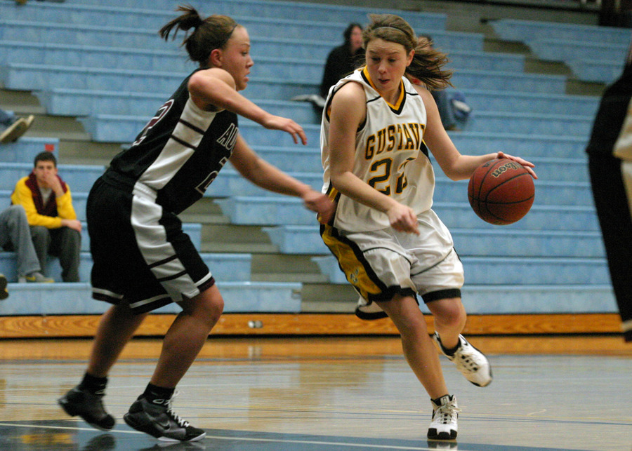 Point guard Colleen Ruane tries to penetrate the Augsburg defense.