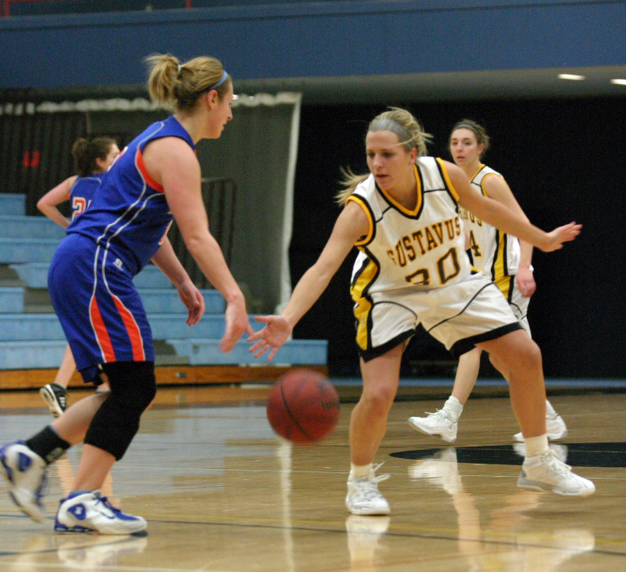 Emily Nelson applies pressure defense on the perimeter.