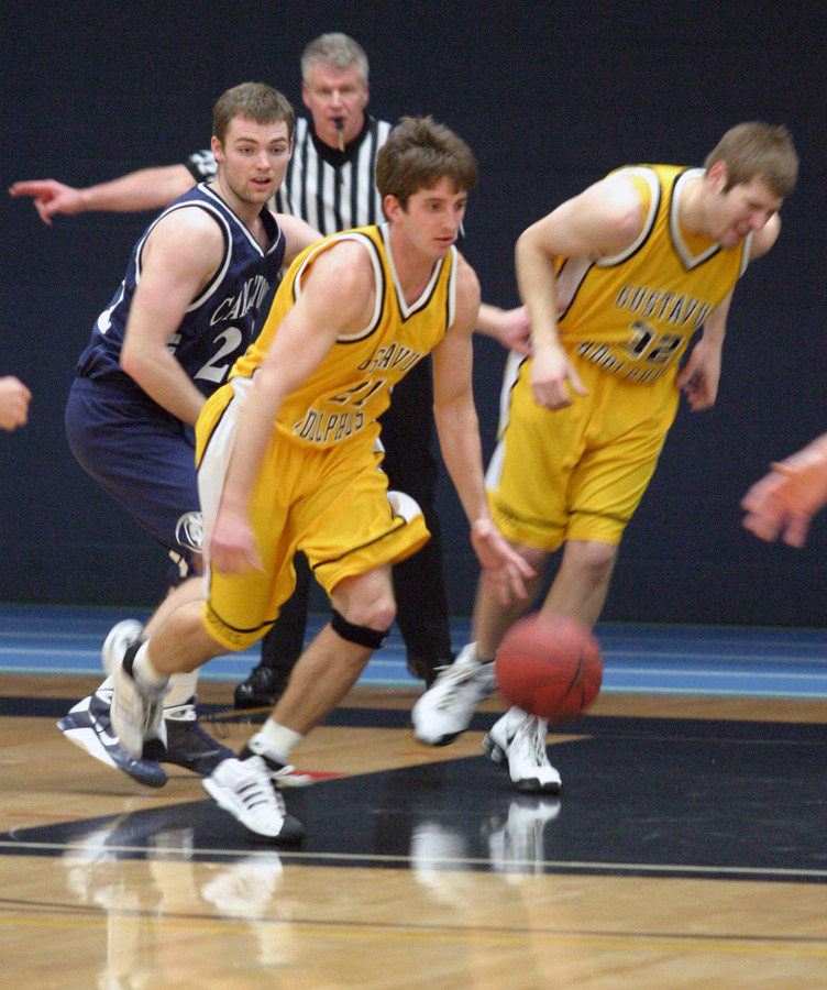 Jesse Van Sickle moves the ball up the court after grabbing a rebound.
