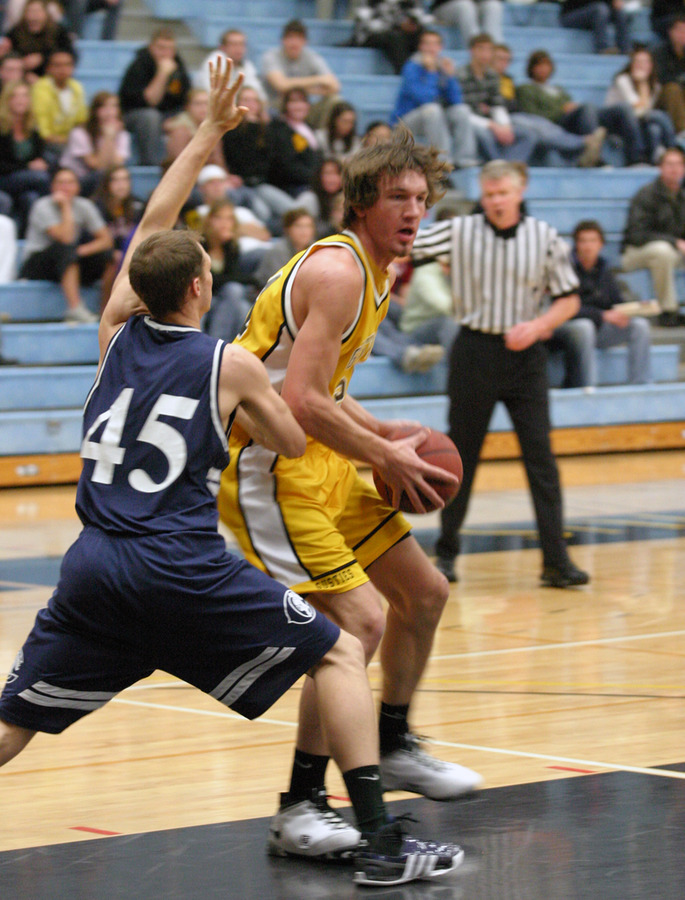 Sam Paulson posts up against a Carleton defender.