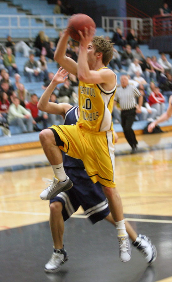 Dan Schmidtknecht goes in for the layup after a steal.