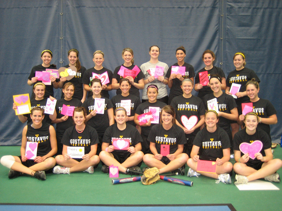 "Softball team displaying valentines they made for ""Valentines for Kids"" program."