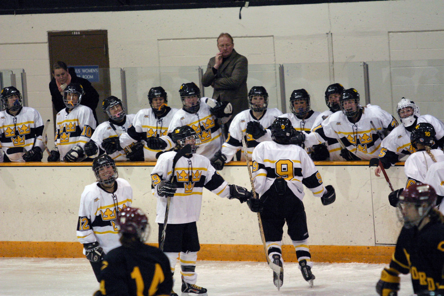 The Gustavus bench celebrates after Melissa Mackley's goal gave the Gusties a 5-0 lead in the third period.