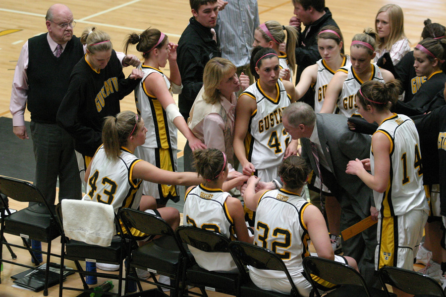 Coach Mickey Haller encourages her team in the huddle late in the game.