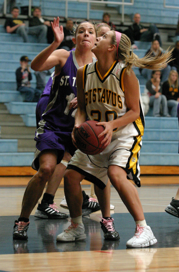 Emily Nelson looks to shoot after a rebound,.