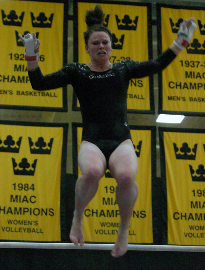 Christine Ashkam dismounts from the uneven bars.