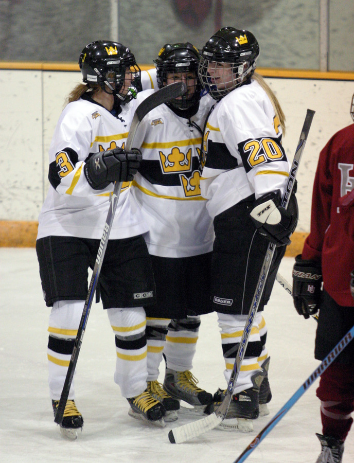 Gina DeNucci (left), and Gracie Olson (right) celebrate with Christine Wcker (center) after Wicker scored the first goal.