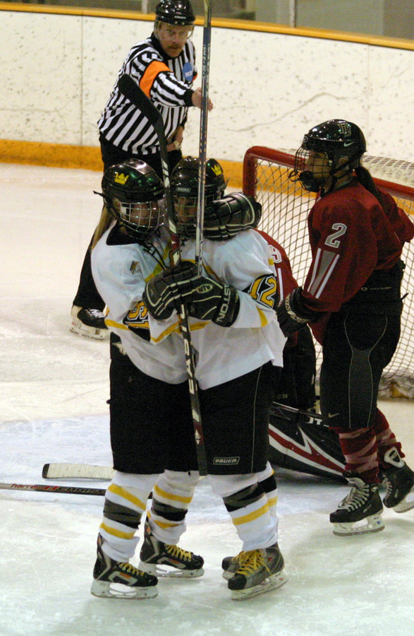 Alyssa Gaulrapp celebrates with Jessie Doig after Doig's goal in the third period.