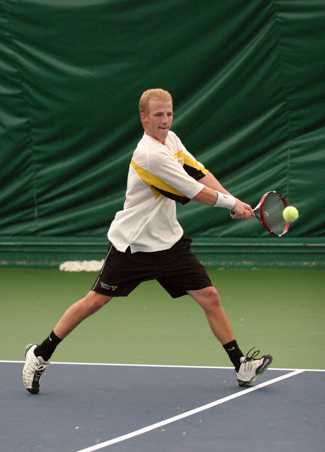 John Kauss reaches for a backhand.
