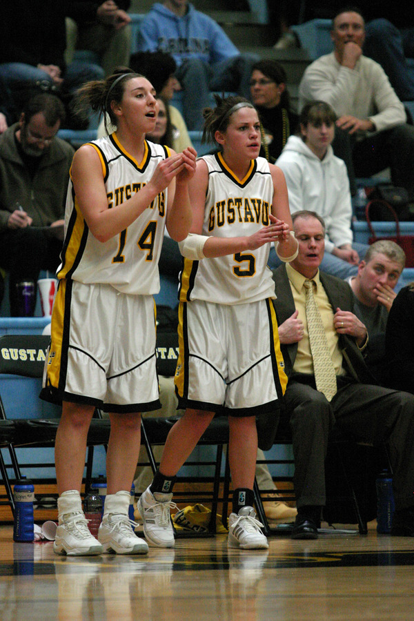 Julia Schultz (left) and Bri Radtke (right) cheer their teammates from the sideline.