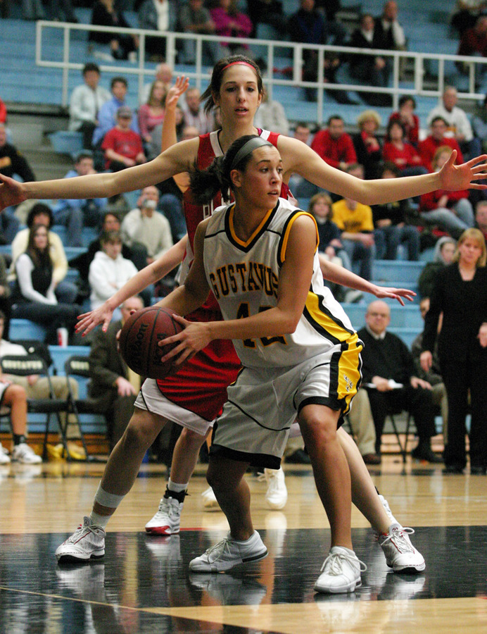 Ava Perry looks for a teammate after grabbing an offensive rebound.