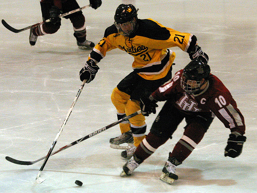 Joe Welch fights to get to the puck.