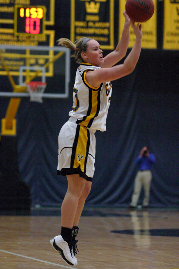 Megan Gaard goes up for one of her two important three-point baskets in the game.