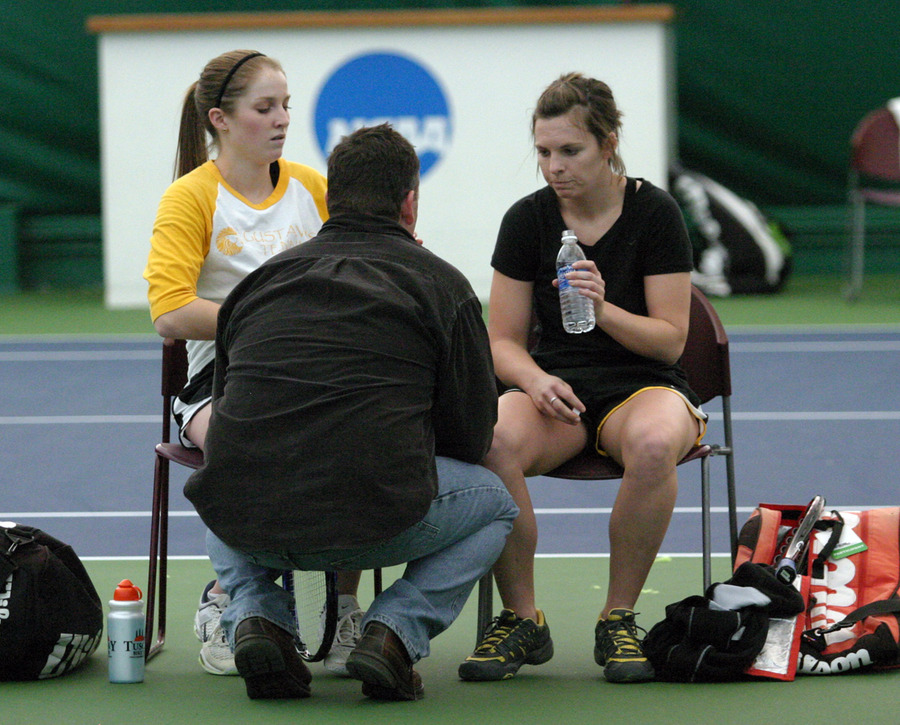Coach Jon Carlson talks to Ali O'Neal (left) and Erica Dobson during their #2 doubles match.