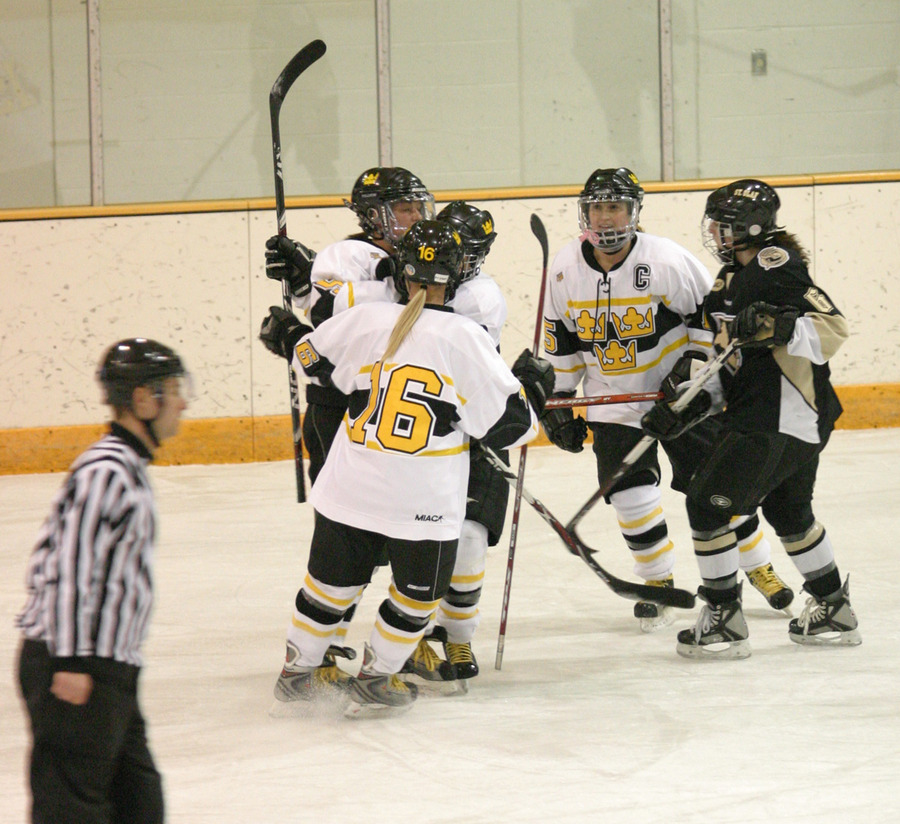 Gustavus celebrates Mari Gunderson's goal late in the first period that gave the Gusties a 1-0 lead.