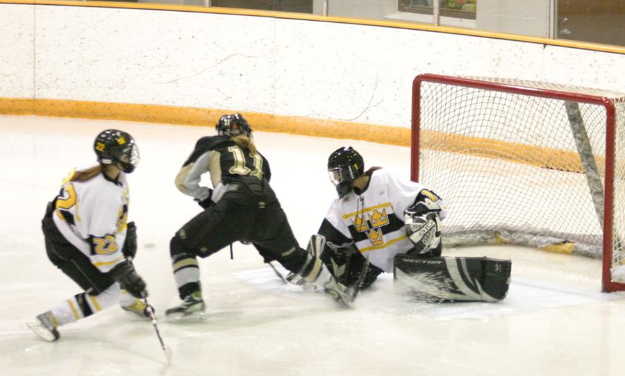 Danielle Justice stops a breakaway attempt by Kayla Hill of St. Olaf.