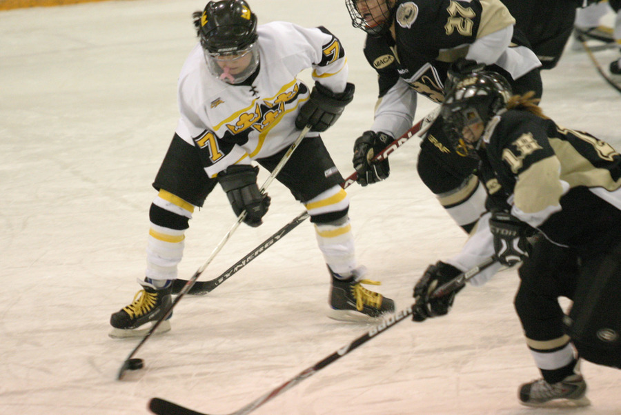 Kathryn DelZoppo attempts to clear the puck for Gustavus.